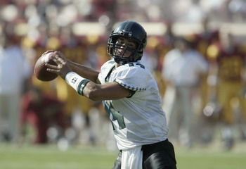 LOS ANGELES - SEPTEMBER 13:  Timmy Chang #14 of the University of Hawaii Warriors throws a touchdown pass against the University of Southern California Trojans at the Los Angeles Coliseum on September 13, 2003 in Los Angeles, California.  USC defeated Haw