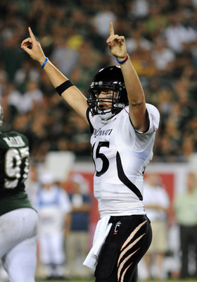 TAMPA, FL - OCTOBER 15: Quarterback Tony Pike #15 of the Cincinnati Bearcats celebrates a touchdown pass against the University of South Florida Bulls October 15, 2009 at Raymond James Stadium in Tampa, Florida.  (Photo by Al Messerschmidt/Getty Images)