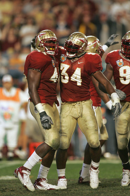 MIAMI GARDENS, FL - JANUARY 3:  Ernie Sims #34of the Florida State Seminoles congratuales Sam McGrew #44 during the 72nd Fed Ex Orange Bowl against the Penn State Nittany Lions at Dolphins Stadium on January 3, 2005 in Miami Gardens, Florida. Penn State d