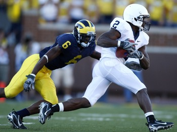 ANN ARBOR, MI - SEPTEMBER 22:  Derrick Williams #2 of the Penn State Nittany Lions outrun the tackle of Donovan Warren #6 of the Michigan Wolverines at Michigan Stadium September 22, 2007 in Ann Arbor, Michigan. Michigan won the game 14-9.  (Photo by Greg