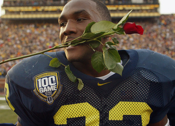 ANN ARBOR, MI - NOVEMBER 22:  Running back Chris Perry #23 of the Michigan Wolverines celebrates by putting a rose in his mouth after the victory against the Ohio State Buckeyes during the 100th meeting of the two teams November 22, 2003 at Michigan Stadi