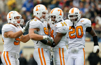 NASHVILLE, TN - NOVEMBER 22:  Nick Reveiz #56, Wes Brown #94, Eric Berry #14 and Nevin McKenzie #20 of the Tennessee Volunteers react after a defensive stop against the Vanderbilt Commodores during the game at Vanderbilt Stadium on November 22, 2008 in Na