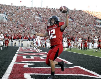 LUBBOCK, TX-OCTOBER 28: Eric Morris #12 of the Texas Tech Red Raiders catches a touchdown pass against the Texas Longhorns  at Jones AT&T Stadium on October 28, 2006 in Lubbock, Texas. (Photo by Layne Murdoch/Getty Images)