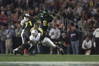 29 Dec 2000:  Maurice Morris #9 of the Oregon Ducks jumps to avoid a tackle by the Texas Longhorns'' defense during the Culligan Holiday Bowl at Qualcomm Stadium in San Diego, California. DIGITAL IMAGE Mandatory Credit: Jeff Gross/ALLSPORT