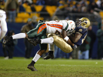 PITTSBURGH - NOVEMBER 29:  Sean Taylor #26 of the Miami Hurricanes puts a hit on Kris Wilson #83 of the Pittsburgh Panthers November 29, 2003 at Heinz Field in Pittsburgh, Pennsylvania.  (Photo by Rick Stewart/Getty Images)