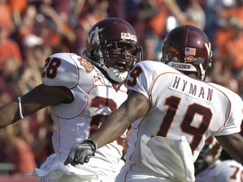 JACKSONVILLE, FL - DECEMBER 1: Running back Branden Ore #28 and split end Josh Hyman #19 of the Virginia Tech Hokies celebrate a score against the Boston College Eagles in the ACC Championship Game at Jacksonville Municipal Stadium on December 1, 2007 in