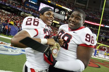 ATLANTA - DECEMBER 30: Brian Mimbs #26 of the Georgia Bulldogs celebrates with Ricardo Crawford #98 after a 31-24 victory over the Virginia Tech Hokies during the Chick-fil-a Bowl on December 30, 2006 at the Georgia Dome in Atlanta, Georgia. (Photo by Str