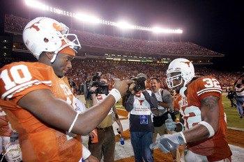 AUSTIN, TX - NOVEMBER 26:  Quarterback Vince Young #10 and running back Cedric Benson #32 of the University of Texas Longhorns celebrate after defeating the Texas A&M University Aggies 26-13 on November 26, 2004 at Royal Memorial Stadium in Austin, Texas.