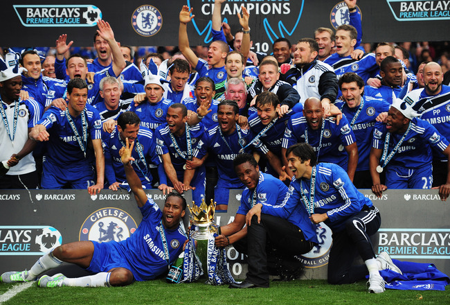 LONDON, ENGLAND - MAY 09:  Chelsea players celebrate with the trophy after the Barclays Premier League match between Chelsea and Wigan Athletic at Stamford Bridge on May 9, 2010 in London, England. Chelsea won 8-0 to win the title.  (Photo by Shaun Botter