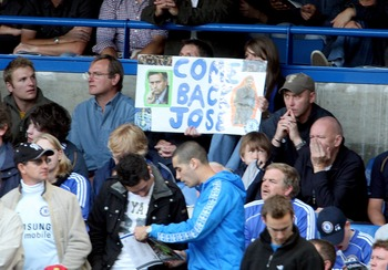 LONDON - SEPTEMBER 29:  Fans hold up a placard urging former Chelsea manager Jose Mourinho to return during the Barclays Premier League match between Chelsea and Fulham at Stamford Bridge on September 29, 2007 in London. (Photo by Phil Cole/Getty Images)