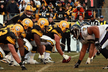 PITTSBURGH - DECEMBER 27:  Ben Roethlisberger #7 of the Pittsburgh Steelers lines up under teammate center Justin Hartwig #62 before the snap during the game against the Baltimore Ravens at Heinz Field on December 27, 2009 in Pittsburgh, Pennsylvania.  (P
