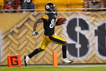 PITTSBURGH - AUGUST 14: Antonio Brown #84 of the Pittsburgh Steelers crosses the goal line on a 64 yard touchdown catch against the Detroit Lions during the preseason game on August 14, 2010 at Heinz Field in Pittsburgh, Pennsylvania. (Photo by Jared Wick
