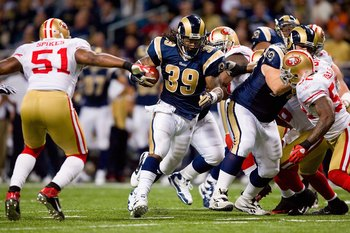 ST. LOUIS - JANUARY 3:  Steven Jackson #39 of the St. Louis Rams carries the ball during the game against the San Francisco 49ers at the Edward Jones Dome on January 3, 2010 in St. Louis, Missouri.  The 49ers beat the Rams 28-6.  (Photo by Dilip Vishwanat