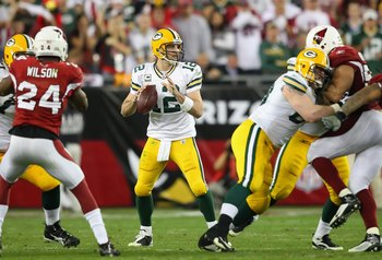 GLENDALE, AZ - JANUARY 10:  Quarterback Aaron Rodgers #12 of the Green Bay Packers drops back to pass during the 2010 NFC wild-card playoff game against the Arizona Cardinals at the Universtity of Phoenix Stadium on January 10, 2010 in Glendale, Arizona.