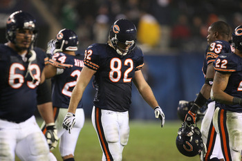 CHICAGO - NOVEMBER 22: Greg Olsen #82 of the Chicago Bears walks off the field with teammates at the end of the Bears' last offensive series against the Philadelphia Eagles at Soldier Field on November 22, 2009 in Chicago, Illinois. The Eagles defeated th