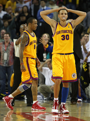 OAKLAND, CA - DECEMBER 03: Stephen Curry #30 and Monta Ellis #8 of the Golden State Warriors look on near the end of the game against the Houston Rockets during an NBA game at Oracle Arena on December 3, 2009 in Oakland, California. NOTE TO USER: User exp