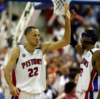 AUBURN HILLS, MI - MAY 13:  Tayshaun Prince #22 and Richard Hamilton #32 of the Detroit Pistons celebrate after Prince blocked a shot by Hedo Turkoglu #15 of the Orlando Magic in the final minute of Game Five of the Eastern Conference Semifinals during th
