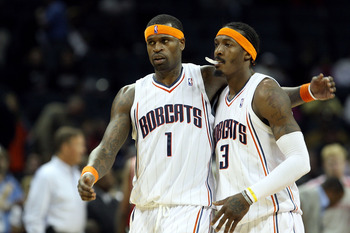 CHARLOTTE, NC - JANUARY 12:  Teammates Stephen Jackson #1 and Gerald Wallace #3 of the Charlotte Bobcats celebrate after a 102-94 victory over the Houston Rockets at Time Warner Cable Arena on January 12, 2010 in Charlotte, North Carolina.  NOTE TO USER: