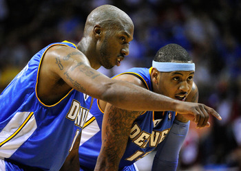 ORLANDO, FL - MARCH 28: Chauncey Billups #1 (L) of the Denver Nuggets speaks with Carmelo Anthony #15 during the game at Amway Arena on March 28, 2010 in Orlando, Florida.  NOTE TO USER: User expressly acknowledges and agrees that, by downloading and/or u