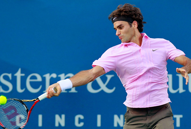 CINCINNATI - AUGUST 20:  Roger Federer of Switzerland returns a forehand to Nikolay Davydenko of Russia during Day 5 of the Western &amp; Southern Financial Group Masters at the Lindner Family Tennis Center on August 20, 2010 in Cincinnati, Ohio.  (Photo by K