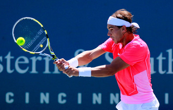 CINCINNATI - AUGUST 18:  Rafael Nadal of Spain returns a backlhand to Taylor Dent during Day 3 of the Western &amp; Southern Financial Group Masters at the Lindner Family Tennis Center on August 18, 2010 in Cincinnati, Ohio.  (Photo by Kevin C. Cox/Getty Imag
