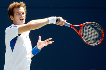 TORONTO, ON - AUGUST 12:  Andy Murray of Great Britain returns a shot to Gael Monfils of France during the Rogers Cup at the Rexall Centre on August 12, 2010 in Toronto, Canada.  (Photo by Matthew Stockman/Getty Images)