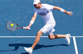CINCINNATI - AUGUST 20:  Mardy Fish returns a forehand to Andy Murray of Great Britain during Day 5 of the Western &amp; Southern Financial Group Masters at the Lindner Family Tennis Center on August 20, 2010 in Cincinnati, Ohio.  (Photo by Kevin C. Cox/Getty