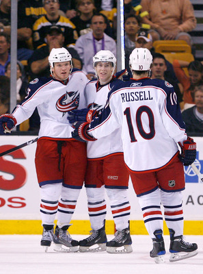 BOSTON, MA - SEPTEMBER 26:  Derek Dorsett #15 of the Columbus Blue Jackets celebrates his goal with his teammates Matt Calvert #69 and Kris Russell #10 against the Boston Bruins during a preseason game at the TD Banknorth Garden on September 26, 2009 in B