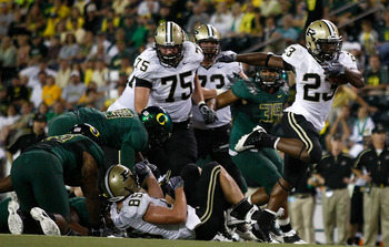 EUGENE, OR - SEPTEMBER 12:   Ralph Bolden #23 of the Purdue Boilermakers runs the ball against the Oregon Ducks at Autzen Stadium on September 12, 2009 in Eugene, Oregon.  (Photo by Jonathan Ferrey/Getty Images)