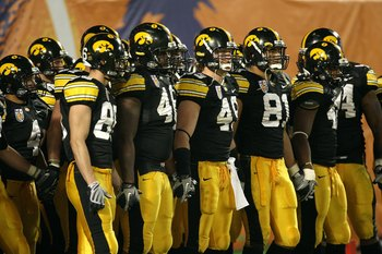 MIAMI GARDENS, FL - JANUARY 05:  The Iowa Hawkeyes get set to walk on the field against the Georgia Tech Yellow Jackets during the FedEx Orange Bowl at Land Shark Stadium on January 5, 2010 in Miami Gardens, Florida.  (Photo by Streeter Lecka/Getty Images