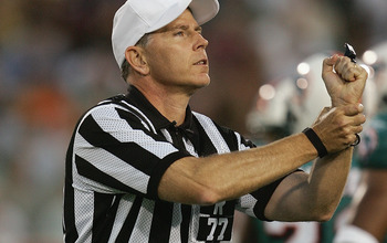 CANTON, OH - AUGUST 8:  Referee Terry McAulay calls a holding penalty during the NFL Hall of Fame pre-season game between the Miami Dolphins and Chicago Bears at Fawcett Stadium on August 8, 2005 in Canton, Ohio. The Bears defeated the Dolphins 27-24. (Ph