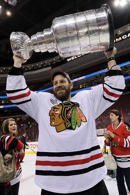 PHILADELPHIA - JUNE 09:  Nick Boynton #24 hoists the Stanley Cup after teammate Patrick Kane #88 scored the game-winning goal in overtime to defeat the Philadelphia Flyers 4-3 and win the Stanley Cup in Game Six of the 2010 NHL Stanley Cup Final at the Wa