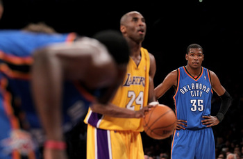LOS ANGELES - APRIL 20:  Kevin Durant#35 of the Oklahoma City Thunder looks on as Kobe Bryant #24 of the Los Angeles Lakers shoots a foul shot during  Game Two of the Western Conference Quarterfinals of the 2010 NBA Playoffs on April 20, 2010 at Staples C
