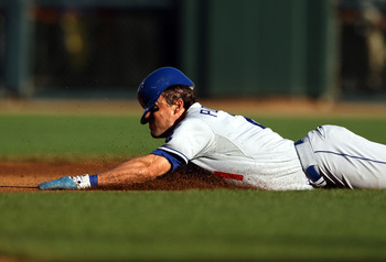SAN FRANCISCO - AUGUST 01:  Scott Podsednik #21 of the Los Angeles Dodgers slides into second base during their game against the San Francisco Giants at AT&T Park on August 1, 2010 in San Francisco, California.  (Photo by Ezra Shaw/Getty Images)