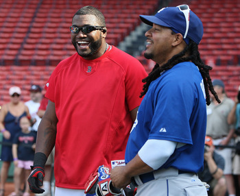 BOSTON - JUNE 18:  Manny Ramirez #99 of the Los Angeles Dodgers interacts with former teammate David Ortiz of the Boston Red Sox before a game at Fenway Park on June 18, 2010 in Boston, Massachusetts. (Photo by Jim Rogash/Getty Images)