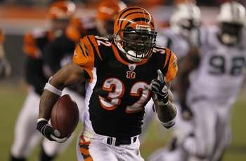 CINCINNATI - JANUARY 9:  Cedric Benson #32 of the Cincinnati Bengals runs for a 47-yard touchdown against the New York Jets in the second half during the 2010 AFC wild-card playoff game at Paul Brown Stadium on January 9, 2010 in Cincinnati, Ohio. (Photo