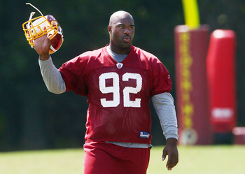 ASHBURN, VA - AUGUST 06:  Defensive lineman Albert Haynesworth #92 of the Washington Redskins walks off the field after missing his eighth consecutive day of practice during Redskins training camp on August 6, 2010 in Ashburn, Virginia.  (Photo by Win McN