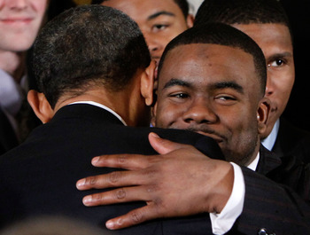 WASHINGTON - MARCH 08:  U.S. President Barack Obama (L) hugs Heisman Trophy winner and running back Mark Ingram (R) during an East Room event to host members of the Alabama Crimson Tide March 8, 2010 at the White House in Washington, DC. Obama welcomed th