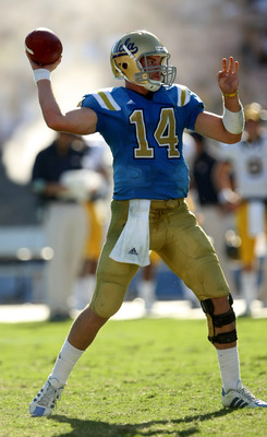 PASADENA, CA - OCTOBER 17: Quarterback Kevin Prince #14 of the UCLA Bruins throws a pass against the California Golden Bears on October 17, 2009 at the Rose Bowl in Pasadena, California.   Cal won 45-26.  (Photo by Stephen Dunn/Getty Images)