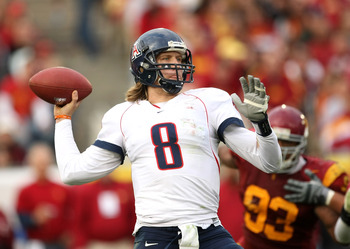 LOS ANGELES - DECEMBER 5:  Quarterback Nick Foles #8 of the Arizona Wildcats throws a pass against the USC Trojans on December 5, 2009 at the Los Angeles Coliseum in Los Angeles, California. Arizona won 21-17.   (Photo by Stephen Dunn/Getty Images)