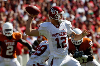 DALLAS - OCTOBER 17:  Quarterback Landry Jones #12 of the Oklahoma Sooners drops back to pass against the Texas Longhorns at Cotton Bowl on October 17, 2009 in Dallas, Texas.  (Photo by Ronald Martinez/Getty Images)