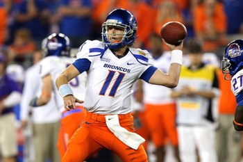 GLENDALE, AZ - JANUARY 04:  Quarterback Kellen Moore #11 of the Boise State Broncos passes the ball against the TCU Horned Frogs during the Tostitos Fiesta Bowl at the Universtity of Phoenix Stadium on January 4, 2010 in Glendale, Arizona.  (Photo by Jed