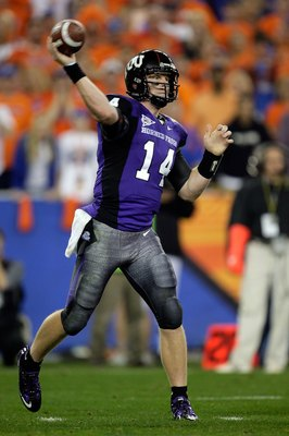 GLENDALE, AZ - JANUARY 04:  Quarterback Andy Dalton #14 of the TCU Horned Frogs passes the ball against the Boise State Broncos during the Tostitos Fiesta Bowl at the Universtity of Phoenix Stadium on January 4, 2010 in Glendale, Arizona.  (Photo by Jamie