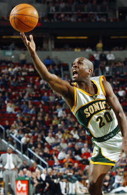 SEATTLE - FEBRUARY 11:  Gary Payton #20 of the Seattle Sonics puts up a shot during the game against the Boston Celtics at Key Arena on February 11, 2003 in Seattle, Washington.  The Celtics won 82-76.  NOTE TO USER: User expressly acknowledges and agrees