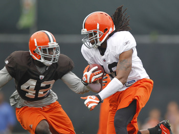 BEREA, OH - AUGUST 04:  Joshua Cribbs #16 of the Cleveland Browns tries to get around Larry Asante #42 during training camp at the Cleveland Browns Training and Administrative Complex on August 4, 2010 in Berea, Ohio.  (Photo by Gregory Shamus/Getty Image