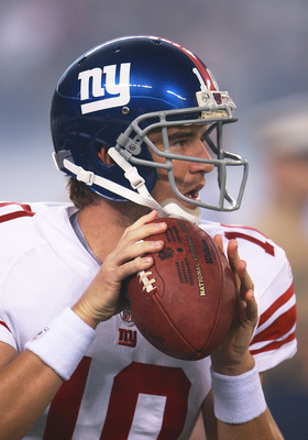 EAST RUTHERFORD, NJ - AUGUST 16:  Eli Manning #10 of the New York Giants warms up before a preseason game against the New York Jets at New Meadowlands Stadium on August 16, 2010 in East Rutherford, New Jersey. The Giants won 31 - 16. (Photo by Andrew Burt