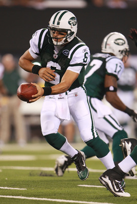EAST RUTHERFORD, NJ - AUGUST 16:  Mark Sanchez #6 of the New York Jets hands the ball off during a preseason game against the New York Giants at New Meadowlands Stadium on August 16, 2010 in East Rutherford, New Jersey. The Giants won 31 - 16.  (Photo by