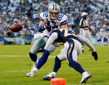 SAN DIEGO - AUGUST 21:  Tight end Jason Witten #82 of the Dallas Cowboys looses control of the ball against the defense of corner back Quentin Jammer #23 of the San Diego Chargers during their preseason NFL football game at Qualcomm Stadium on August 21,