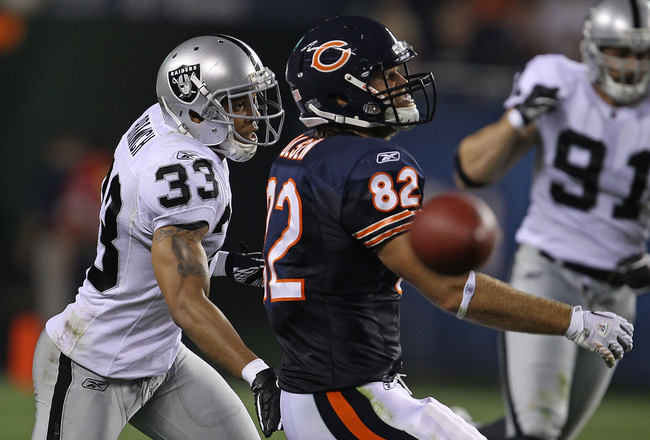 CHICAGO - AUGUST 21: Tyvon Branch #33 of the Oakland Raiders breaks up a pass intended for Greg Olsen #82 of the Chicago Bears during a preseason game at Soldier Field on August 21, 2010 in Chicago, Illinois. The Raiders defeated the Bears 32-17. (Photo b