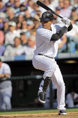 DENVER - APRIL 09:  Carlos Gonzalez #5 of the Colorado Rockies takes an at bat against the San Diego Padres during MLB action on Opening Day at Coors Field on April 9, 2010 in Denver, Colorado. The Rockies defeated the Padres 7-0.  (Photo by Doug Pensinge